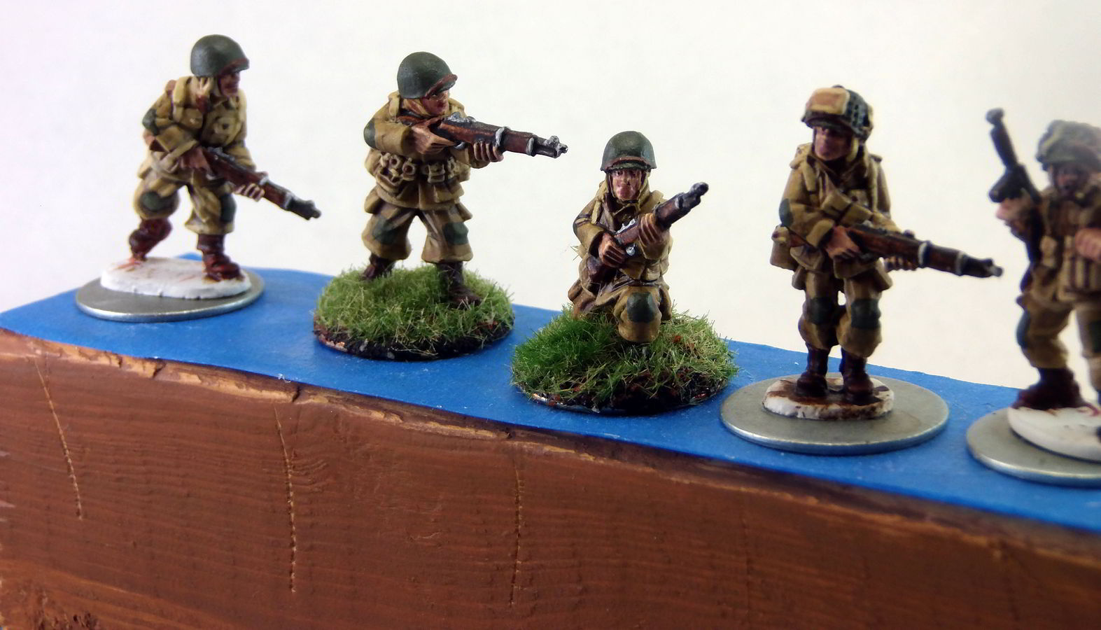 Several airborne figures, magnetically mounted to a 2x4 for varnishing